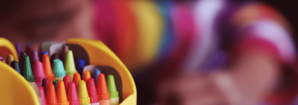An image of a child coloring in for the Benefits of Colouring pages banner